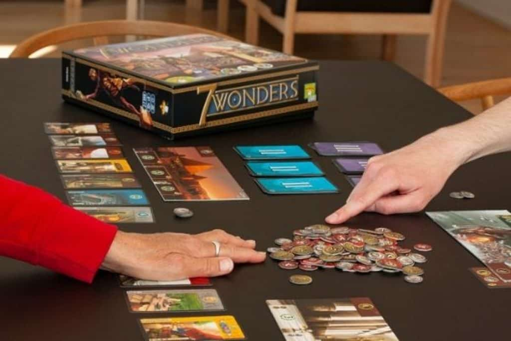 People playing 7 Wonders board game