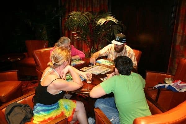 People playing Puerto Rico board game