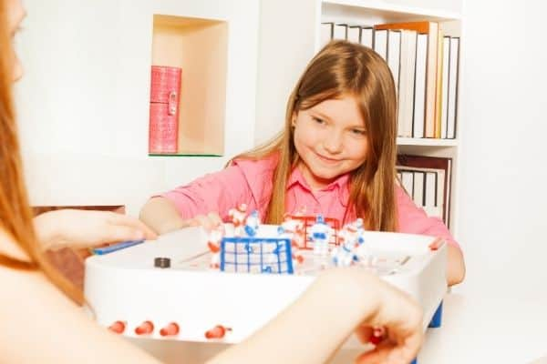 Young girls playing board game at home