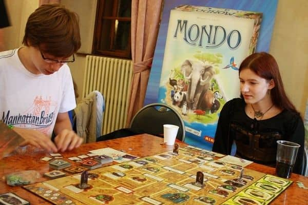 Teenagers playing Arkham Horror board game