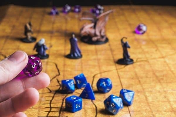 Person holding a dice for RPG board game