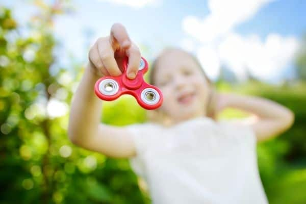Kid playing with fidget spinner