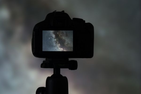 Camera with screen showing the night sky