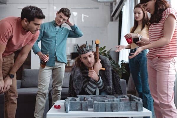 Person wearing a costume while playing RPG board game with friends