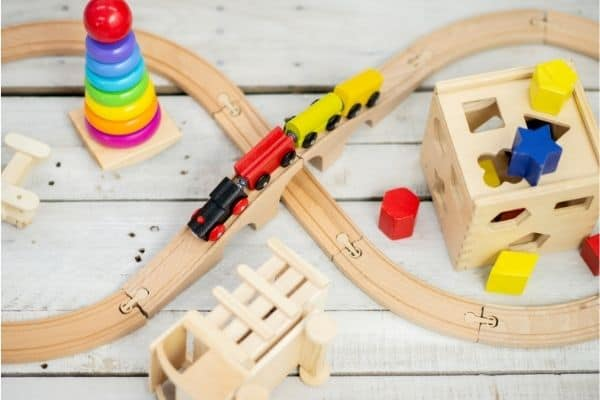 Train set with wooden railway and colorful trains and other toys