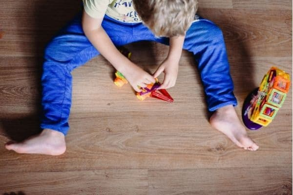 Child building with magnetic toys