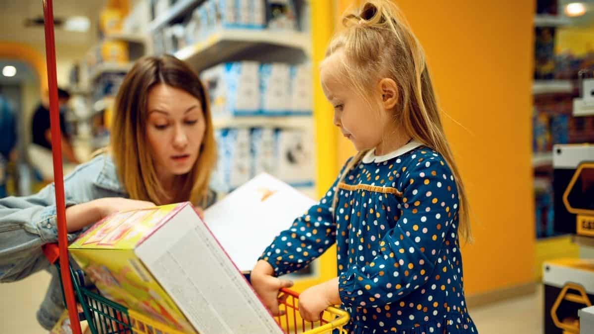 Parent and child buying a board game