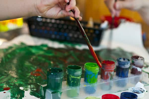 Kids painting with paints - messy
