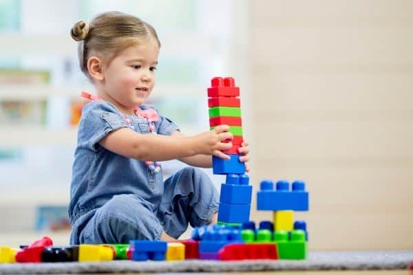 Young girl playing with educational toys
