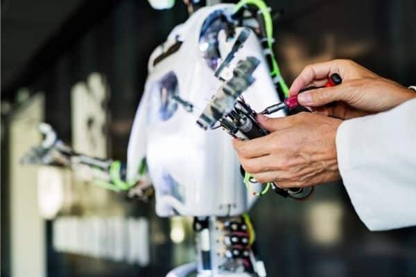 Inventor working on AI robot