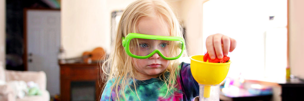 Young girl using a kids STEM kit