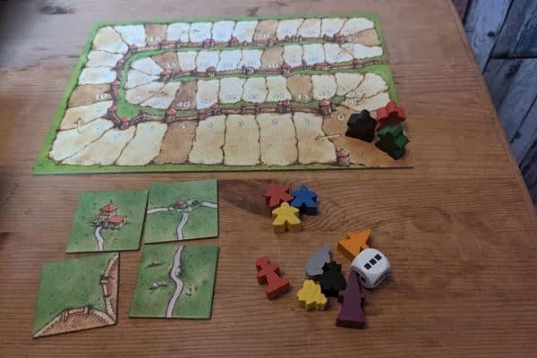 Carcassonne tiles, land cards, dice, and followers