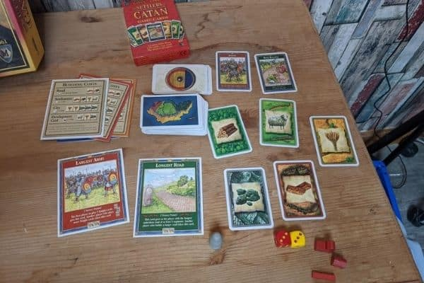 Catan game cards laid out on the table