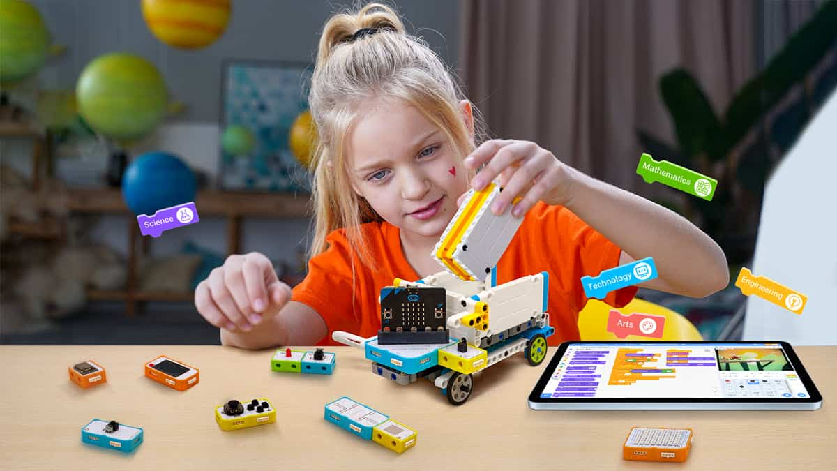Girl playing with Crowbits STEM toy