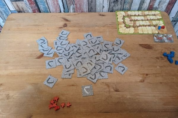 Carcassonne land cards spread out on a table