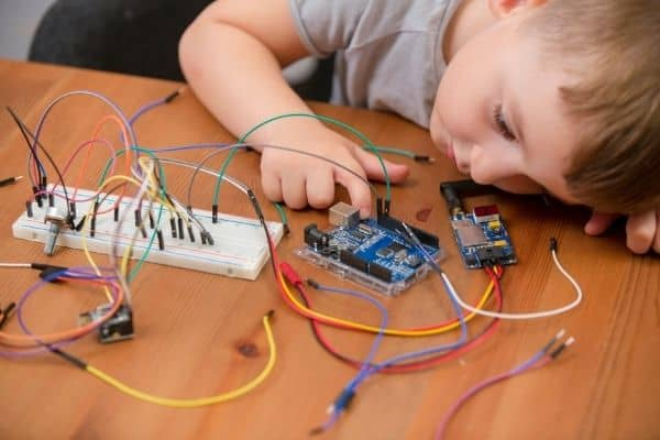 young boy with arduino kit